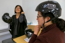 The omnipresence of bike- and scooter-share companies in St. Louis means more people are whizzing to work. Even though WashU employees are not allowed to ride them to meetings, people will continue using them around campus. The Office of Technology Management (OTM) on Nov. 14 gave away 25 WashU/OTM-branded helmets. (Photo: Sid Hastings/Washington University)