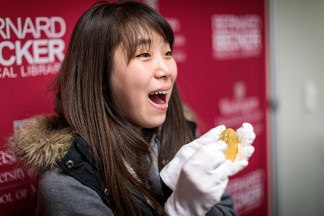 DBBS student Hyeim Jung shows her excitement at getting her photo taken with a Cori Nobel Prize medal at Becker Medical Library's re-opening celebration Oct. 25. (Photo: Matt Miller/School of Medicine)