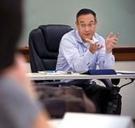John Inazu in a chair
