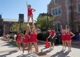 The Washington University cheerleaders got the Fall Festival crowd fired up for the Bears football game against the College of Wooster Fighting Scots. The Bears went on to win the game, 24–20. (Jerry Naunheim Jr.)