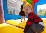 Children's activities, such as the bounce house, added to the family friendly atmosphere of Fall Festival. (Jerry Naunheim Jr.)