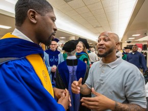 Lerone Martin, associate professor in the John C. Danforth Center on Religion and Politics, chats with a student.