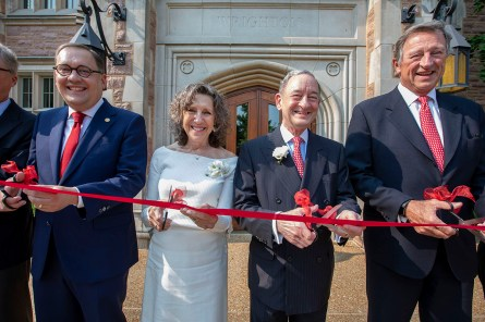 Chancellor Andrew Martin (left), Risa Zwerling Wrighton, former Chancellor Mark Wrighton and Craig Schnuck, chair of the Board of Trustees, join with others at the university in celebrating the dedication of Mark S. Wrighton Hall on May 31. (Photo: Joe Angeles/Washington University)