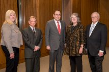 Interim Provost Marion G. Crain (left) and Chancellor Andrew D. Martin (center) recognized faculty award recipients (from left) Yoram Rudy, Fiona Marshall and Gary Stormo during a Nov. 8 ceremony in Emerson Auditorium.
