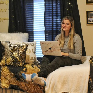 Daniela Pasquarello, a sophomore at Olin Business School, combines gold and dark colors to give her room a chic glamour. (Photo courtesy of Pasquarello)