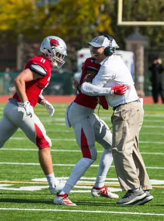 "Bruton captured coach Larry Kindbom hugging junior defensive back Andrew Whitaker after Whitaker caught an interception against Augustana College on Nov. 2, 2019. Kindbom retired this year after 31 seasons as Bears head coach. ""I really enjoyed covering him and his teams. He really had a special relationship with his players,"" Bruton said."
