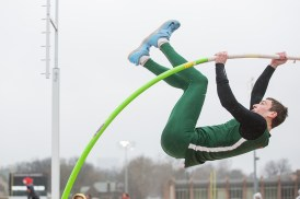 Tim Goblirsch lifts himself through the rain at the WashU Invite in March 2019.