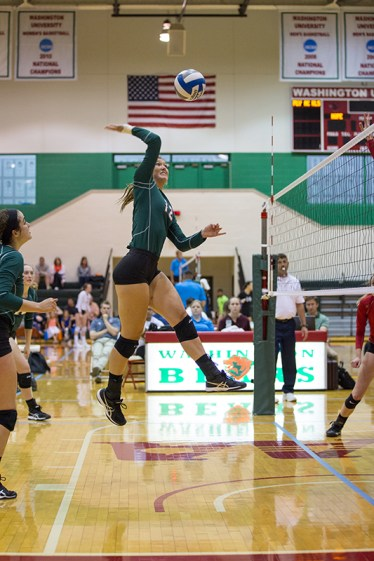 """Bruton considers volleyball one of the more challenging sports to shoot. """"You need to be near the net, but not shoot through it,"""" Bruton explained. In this photo, Bruton shot Leila King as she spiked the ball during a 2017 game. (All photos courtesy of Grace Bruton/Student Life)"""