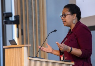 Nicole Hudson, assistant vice chancellor at the Academy for Diversity, Equity, and Inclusion, addresses the participants in Hillman Hall's Clark-Fox Forum. (Photo: Joe Angeles/Washington University)