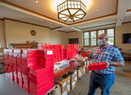"William Hicks, mail services operator in Admissions, prepares for ""return to work"" on the Danforth Campus in June. (Photo: Joe Angeles/Washington University)"