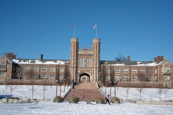 snow surrounds Brookings Hall