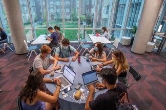 Juniors Sophia Dinte, Gage Fuller, Gregory Michaelides, Abby Hutchison, Toby Utterback, and David Higuchi collaborate in the newly opened McKelvey Hall on the Danforth Campus. (Photo: Joe Angeles/Washington University)