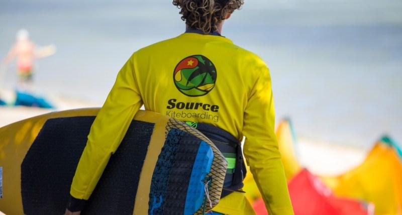 kitesurfer wearing mystic harness and source rashvest