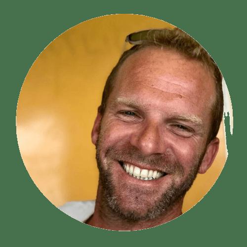 kitesurf instructor smiling with yellow background