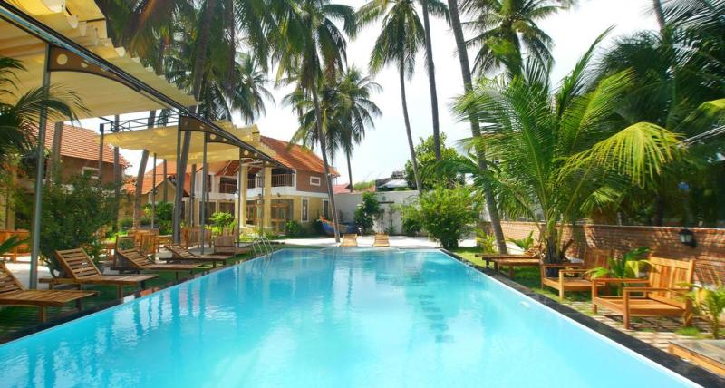 swimming pool in garden with duplex accommodation