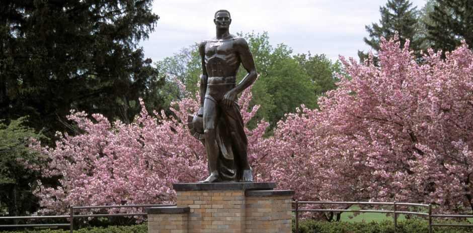 Spartan statue on MSU's campus with trees behind it.