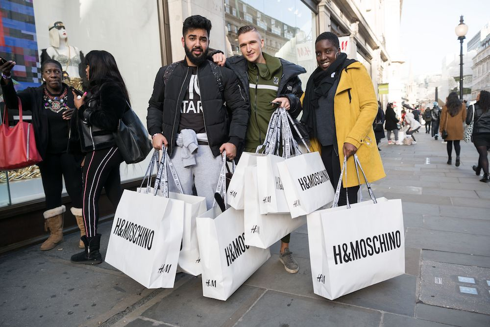 Customers leave with H&M and Moschino shopping bags.