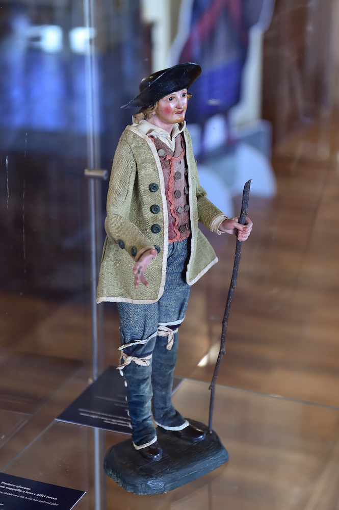 Diesel showcased a reproduction of the oldest-documented jeans fabric, featuring denim trousers modeled after a historic nativity figurine.