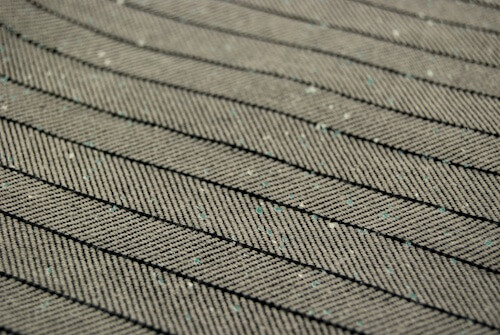 100% Cotton Pinstripe – A clear favorite at the Premiere Vision Show in Paris, it creates the look of an expensive novelty yarn using pigment printing.