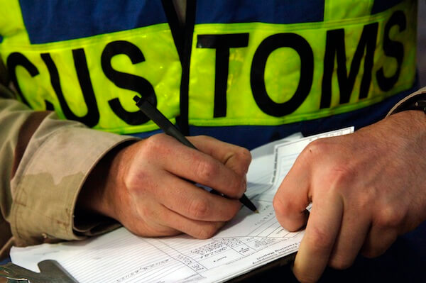 061209-N-8148A-067 Camp Patriot, Kuwait (Dec. 9, 2006) - A customs border clearance agent assigned to Navy Customs Battalion Romeo keeps record of each inspection. Navy Customs Battalion Romeo, comprised of more than 450 reservists, was mobilized, trained, equipped and deployed by the Navy Expeditionary Logistics Support Group and is an operational force under the Navy Expeditionary Combat Command. U.S. Navy photo by Mass Communication Specialist 2nd Class Kitt Amaritnant (RELEASED)