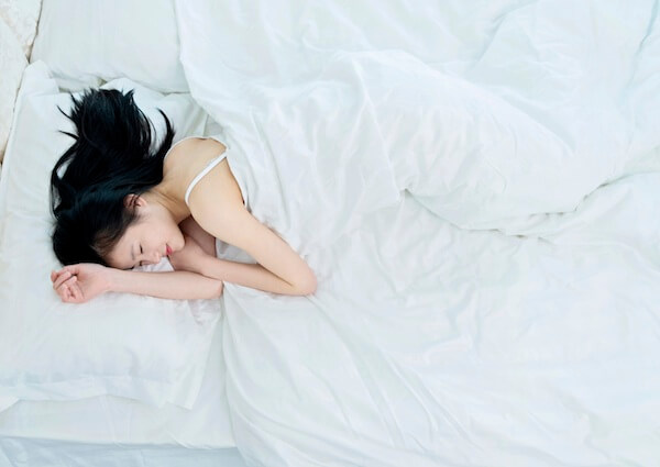 Portrait of a beautiful young asian woman sleeping blissfully.
