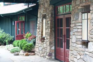 Front entrance to the Sourwood Inn made of stone