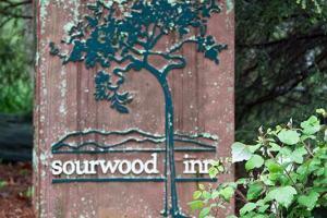 Sourwood Inn metal sign