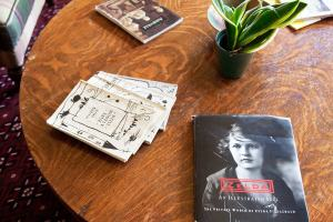 Zelda Fitzgerald magazine and other reading items on a wooden table