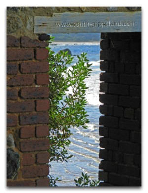 looking through the doorway of an old lime kiln at Walkerville South beach in South Gippsland, Victoria.