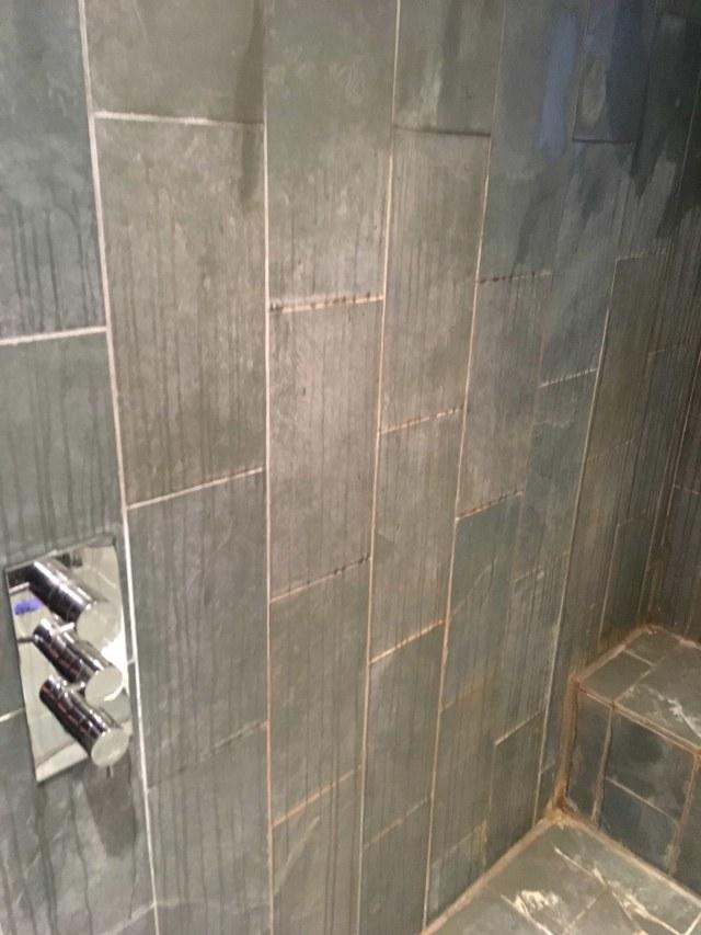Limescale Stained Slate Shower Tiles Before Renovation in Teddington
