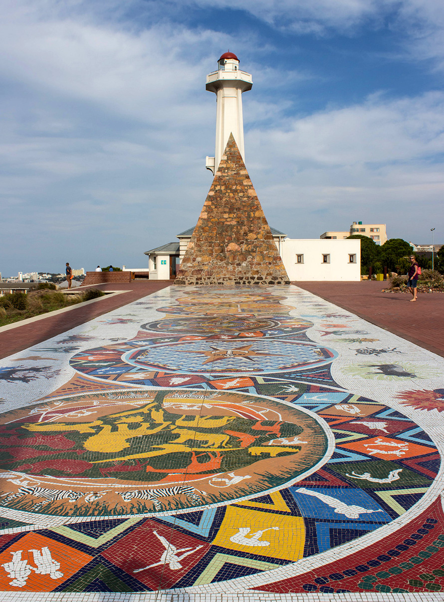 "The lighthouse, pyramid and mosaic in the Donkin Reserve in Port Elizabeth. The reserve is four hectares of green space off Belmont Terrace overlooking the city. It was set aside for the people of Port Elizabeth in perpetuity by Sir Rufane Donkin, acting governor of the Cape Colony from 1820 to 1821. <br />Donkin named the city after his wife Elizabeth, who had died in Meerut, India in 1818. The stone pyramid bears a touching inscription to Elizabeth: ""In memory of one of the most perfect of human beings, who has given her name to the Town below."" <br />While the pyramid and lighthouse were built in the 1800s, the mosaic was created in the 1990s. It visually tells the history of the people of Port Elizabeth and the Eastern Cape. (6000.co.za, CC BY-NC-ND 2.0)"