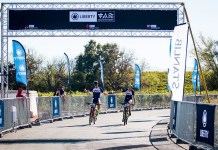 Arno du Toit (left) and Gert Heyns cross the finish line at Nederburg Wine Estate near Paarl on the 50km final stage of the Liberty Winelands Encounter mountain-bike race, presented by STANLIB, to win the overall honours today. Picture: Robert Ward