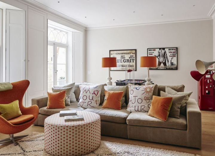 Living Room With Orange Wall Accent | Conceptstructuresllc.com