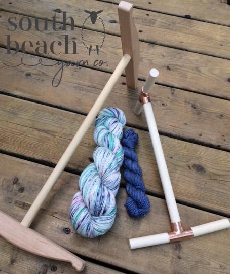 2 Niddy Noddies and 2 skeins of yarn