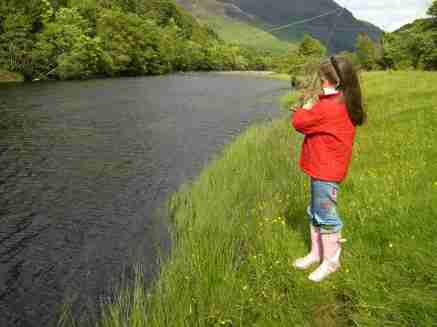 A keen fisherwoman learning the trade