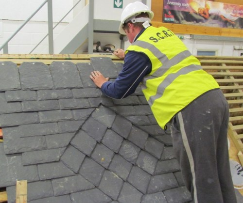 Decorative diamond pattern set into a random slate roof