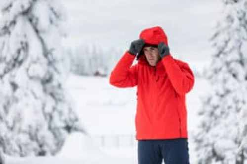 man dressing for cold weather to minimize heart health risks