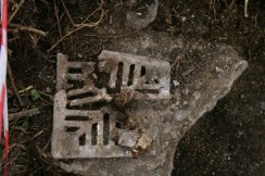 Fragmented cast iron grating, probably for our gully drain; 22nd September 2013.