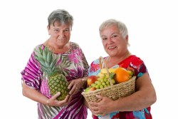 elderly women with fruit gifts