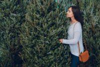 girl-chooses-a christmas tree