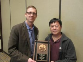 Dr. Peng Chee (right) receives the 2016 Cotton Genetics Research Award from Dr. Tom Brooks of Americot.