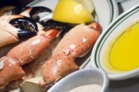 plate of florida stone crab claws with lemon butter and mustard as photographed in south beach miami florida
