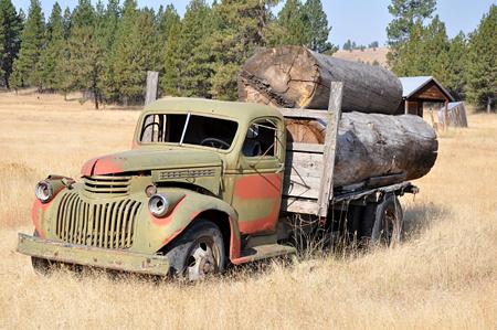 old truck big logs