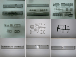 ex LSWR Gate Stock parts hot of of the injection moulding machines, can you guess what each part is?