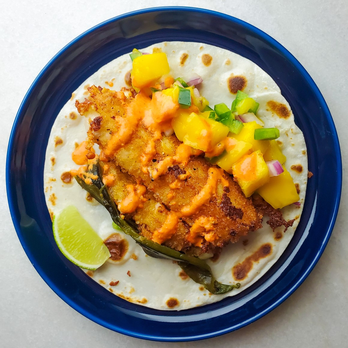fried oaxaca cheese tacos with red pepper cream sauce and mango salsa feature image