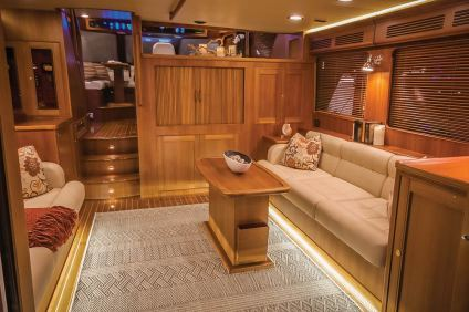 The well-apointed salon is permeate with rich hardwoods the evoke an classic era of yacht building. Photo: jlambertphotos.com