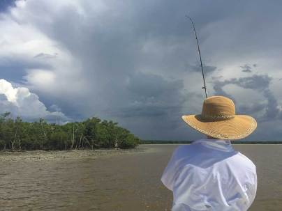 Fishing against the mangrove islands usually leads to a rewarding catch of redifsh and snook, but keep an eye on the weather; it can be unpredictable in the Ten Thousand Island region. Photo credit: Susanna Botkin
