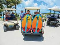 Young lads head for the pig roast at Nippers on Great Guana. Photo Credit: Cher Foth