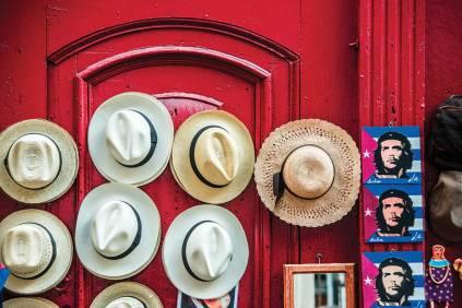 Panama hats and Che Guevara adorn a souvenir stand in Havana.