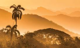 Sunrise illuminates the mountains in southern Cuba